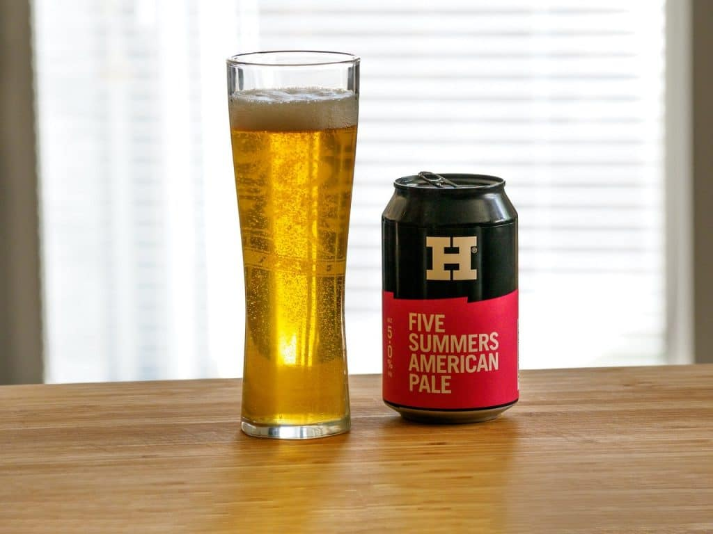 glass of pale beer with tin